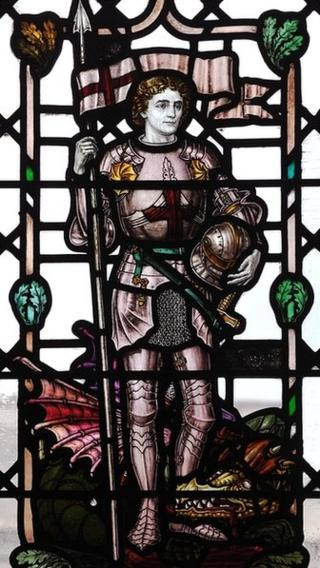 Stained glass window depicting St George and the Dragon