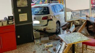 Car in supermarket cafe