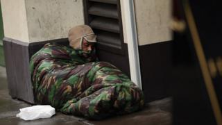 Homeless man sleeps on the streets in London