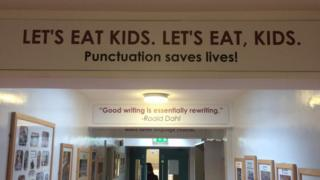 A mural on a wall at St Paul's High School in Bessbrook that reads: Let's eat kids. Let's eat, kids. Punctuation saves lives!