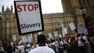 Anti-slavery activists rally outside Parliament, in London