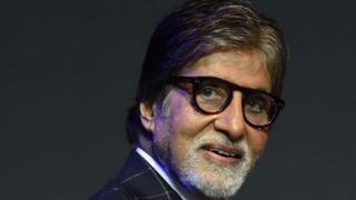 Bollywood actor Amitabh Bachchan looks on during a commercial event in Mumbai on May 17, 2018.