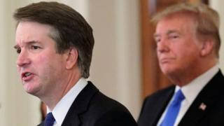 US President Donald Trump listens to his nominee for the US Supreme Court Brett Kavanaugh speak during his nomination announcement at the White House in Washington on, 9 July 2018