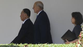 White House chief of staff John Kelly (C) escorts North Korean General Kim Yong-chol (L) to the White House on 1 June 2018