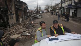 Engineers from New York's Department of Environmental Protection assess the damage