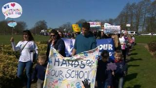 Protesters march against plans to close a number of Northumberland schools