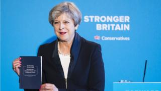Theresa May holds the Conservative party's election manifesto