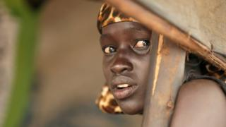 One South Sudanese rufugee girl show face for di Nguenyyiel refugee camp as US ambassador to UN Nikki Haley (she no dey di picture) visit Gambella Region for Ethiopia on October 24, 2017.
