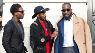 Tinie Tempah wearing a Hardy Amies suit (right)