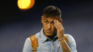 Barcelona's Neymar leaves after a Spanish La Lira soccer match between Atletico Madrid and Barcelona at the Vicente Calderon stadium in Madrid, Saturday, Sept. 12, 2015.
