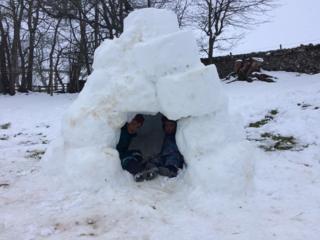 Two boys in igloo