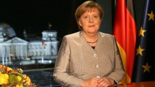 German Chancellor Angela Merkel records her televised New Year's address to the nation at the Chancellery on December 30