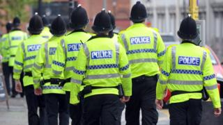 Police officers on a street in Manchester