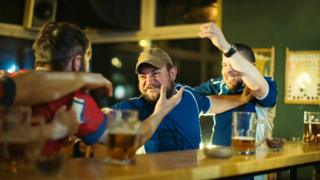 A pub fight, posed by models
