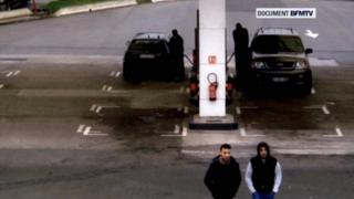 Paris shooting suspect Salah Abdeslam and suspected accomplice Hamza Attou are seen at a petrol station on a motorway between Paris and Brussels, in Trith-Saint-Leger, France on 14 November 2015