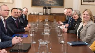 Representatives from the UK and Irish governments at Stormont, including Theresa May and Leo Varadkar