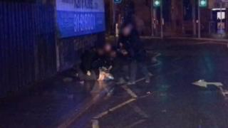 The PSNI said officers saw the man threatening passers-by on the street