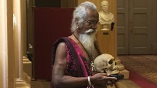 Vedda chief with skull