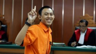 Indonesian militant Dodi Suridi, 23, smiles during his trial in Jakarta, Indonesia, 20 October 2016.
