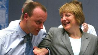 Меркель і Мерц