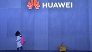 An attendee walk by the Huawei booth at CES 2019 at the Las Vegas Convention Center on January 8, 2019 in Las Vegas, Nevada.