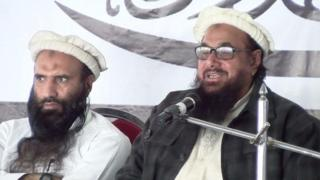 Hafiz Saeed (right) addresses activists in Muzaffarabad 11 January