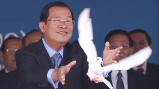 Cambodian Prime Minister Hun Sen (R) releases a dove during the Victory Day parade in Phnom Penh, Cambodia, 07 January 2020