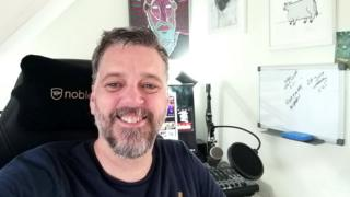 Iain Lee at his desk