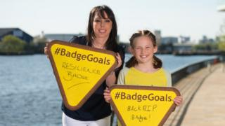 Gymnast Beth Tweddle with Brownie show their badge goals