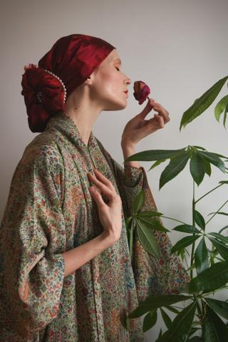 Julia Keil smelling a rose