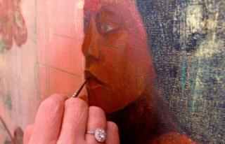 Geraldine works on one of her portraits