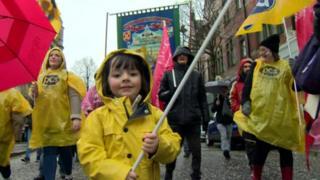 child at women's rally