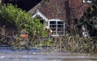 Fire and rescue personnel visit flooded properties in Bewdley