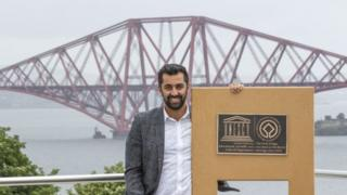 Humza Yousaf with the plaque