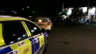 police cars in front on pub