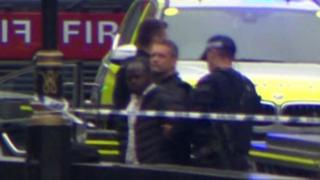 The suspect being led away by police
