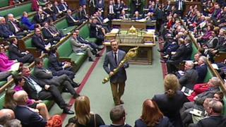 Lloyd Russell-Moyle carries the mace through the Commons chamber