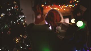 person sitting at home at Christmas