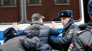 Russian police search an opposition activist during a protest rally in central Moscow in support of Vyacheslav Maltsev's Artillery preparation movement