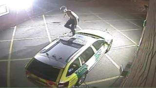 The man with no top on climbed on the roof of a rapid response car and jumped