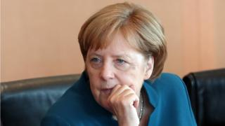 German Chancellor Angela Merkel looks on at the beginning of the weekly meeting of the German cabinet