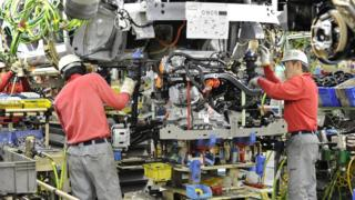 Nissan workers install engine into electric vehicle in 2011