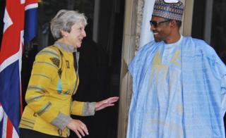 UK leader Theresa May greeting Nigerian President Muhammadu Buhari in Abuja, Nigeria - Wednesday 29 August 2018