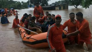 Passengers being rescued in rubber boats