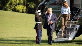 US President Donald Trump, and First Lady Melania Trump disembark Marine One on the South Lawn of the White House n Sunday, August 4, 2019.