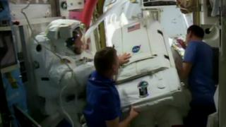 astronauts at the airlock