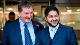 Former Uber drivers James Farrar (L) and Yaseen Aslam