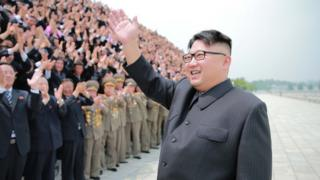 North Korean leader Kim Jong-un waves at a crowd