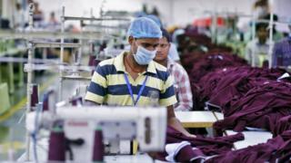 Employee working inside a garment factory of Orient Craft Ltd in Gurgaon