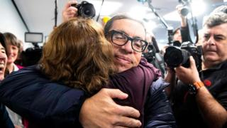 Jens Söring, who served 33 years in prison for a double murder, is hugged by a supporter as he arrives for a press conference in Germany, 17 December 2019